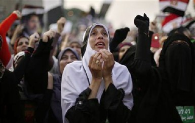 A supporter of deposed Egyptian President Mohamed Mursi attends a protest outside the Rabaa Adawiya mosque in Cairo July 8, 2013. (Reuters/Suhaib Salem)