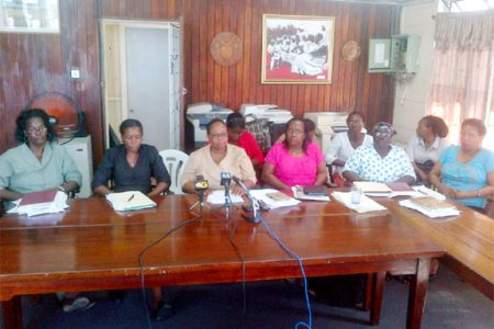 GPSU's acting President Deborah Murphy (centre), flanked by the union's 2nd VP Dawn Gardener (second from left) and 3rd VP Carmelita Laulys (third from right, front) at a news conference yesterday