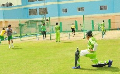 Pakistan going through their net session at the Guyana National Stadium yesterday (See story on page 26)