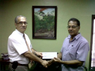 President of the RBC, Brian Allen (right), collecting the sponsorship cheque from Marketing Director of John Fernandes Group, Bernie Fernandes yesterday.