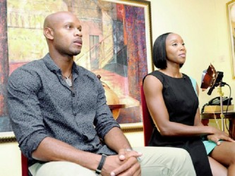 Olympians Asafa Powell and Sherone Simpson prior to the interview at the New Kingston offices of Samuda and Johnson.
