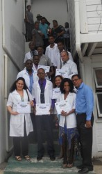 Some of the new doctors with officials of the Berbice Regional Health Authority after the graduation ceremony