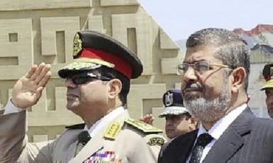 Egypt'sChief of Staff Abdel Fattah al-Sisi (L) and Egyptian President Mohamed Morsi in April, 2013. Photo: Reuters
