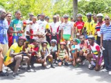 Winners and runners up of the National Sports Commission (NSC) 11-race cycling meet pose with their trophies and prime prizes at the completion of yesterday's event.