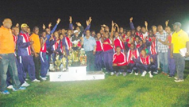 Headquarters athletes celebrate after retaining their title in the Police annual track and field championship last Friday evening at the Police Sports Club ground, Eve Leary.