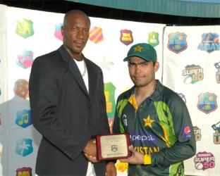 Umar Akmal receives his Man-of-the –Match award from former West Indies fast bowler Nixon Mc Lean. (photo courtesy WICB media)