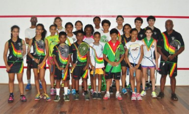 VICTORIOUS! Some members of the Guyana junior boys and girls' squash team whichj won the overall team title for the ninth time at the annual Carribbean junior squash championships which ended yesterday in Trinidad and Tobago.