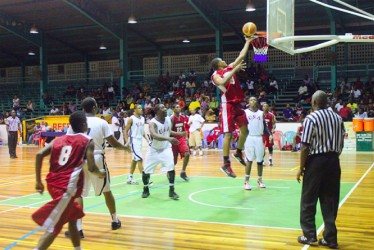 Action in the YBG/Partners in Christ All-Star basketball night U20 matchup between Guyana and USA.