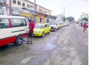 These motorists line up to purchase what is left of the gasoline at Farley's filling station