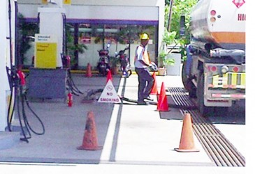 A fuel truck is seen here depositing fuel into the underground fuel tank at the Sol gas station on Vlissingen Road