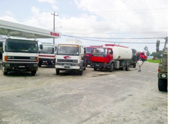 Fuel trucks flock the Rubis fuel storage facility yesterday afternoon to procure whatever fuel they can