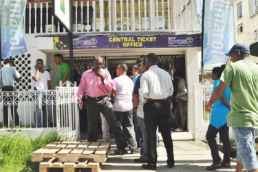 Some of the eager cricket fans awaiting their turn to purchase tickets yesterday.