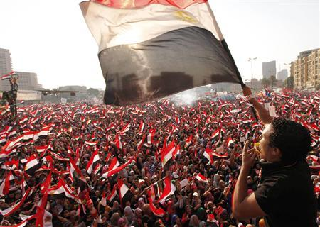 Protesters against Egyptian President Mohamed Mursi wave national flags in Tahrir Square in Cairo July 3, 2013. REUTERS/Mohamed Abd El Ghany