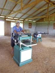 Jason Larose installing the new power-saw