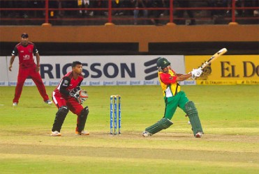 Guyana's Amazon Warriors skipper Ramnaresh Sarwan smashes a six in his cameo knock. (Photos by Orlando Charles)