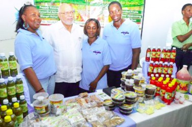 President Donald Ramotar (second from left) with exhibitors at the 9th annual Berbice Expo (GINA photo)