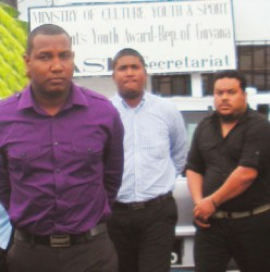Anthony Thomas, Ravindra Singh and Gregory Luke march towards the Georgetown Magistrates' Court complex on Middle Street for their arraignment on a charge of conspiracy to traffic cocaine, in wake of last week's discovery of over 11 kilos of the drug at the Cheddi Jagan International Airport, Timehri, where all three men were serving as enforcement officials.