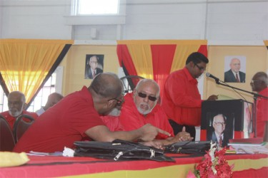 When Presidents meet: Former President Bharrat Jagdeo in talks with his successor President Donald Ramotar at the opening of the PPP's 30th Congress yesterday at the JC Chandisingh Secondary School. (Photo by Arian Browne)