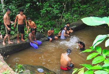 Villagers enjoying a swim at the Hosororo Falls