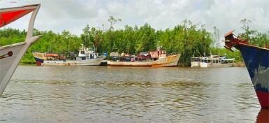 Boats docked at the Kumaka Landing