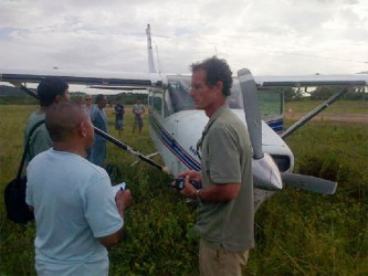 The pilot of the plane (right) speaking to a law enforcement officer shortly after the incident