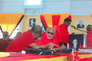 President Donald Ramotar (right) conversing with former President Bharrat Jagdeo at the PPP's 30th Congress on Friday at Port Mourant. Not visible is Head of the Presidential Secretariat, Dr Roger Luncheon. (Arian Browne photo)