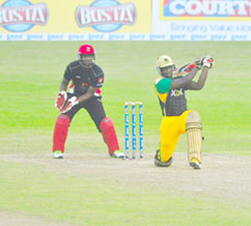Andre Russell on the attack hitting the first of his three massive sixes. (Orlando Charles photo)