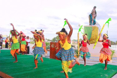 A celebratory dance with the monument in the background