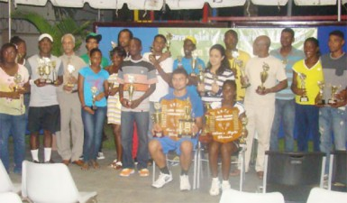 The respective divisional champions displaying their prizes at Tuesday's presentation ceremony.