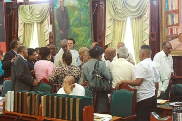 Huddle: One of the intense PPP/C huddles during yesterday's deliberations on the order of business for the day.