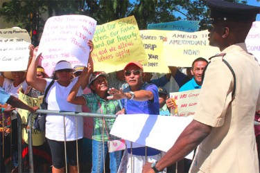 We have grievances: Amerindians from several regions protesting outside of Parliament yesterday.