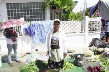 Three generations at Port Mourant market: Vegetable vendor Sita with her daughter-in-law and grandchild