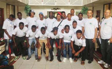 The Suriname male football team poses for a photo opportunity at the Ocean View International Hotel after arriving in Guyana to compete in the annual Inter Guiana Games.