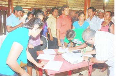 A large group of people rushed to sign the petition which calls for the Amerindian Act of 2006 to be amended. (Arian Browne photo)