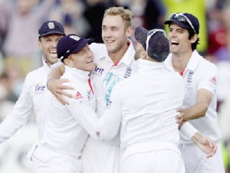 Chris Broad and his England teammates celebrate their astonishing win.