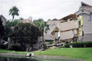 A section of the Summer Bay Resort lies collapsed after a large sinkhole opened on the property's grounds in Clermont, Florida August 12, 2013. REUTERS/David Manning