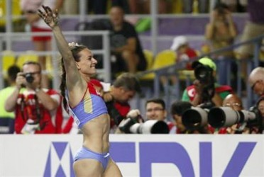 Yelena Isinbayeva of Russia celebrates her victory in the women's pole vault final at the IAAF World Athletics Championships at the Luzhniki stadium in Moscow August 13, 2013. Credit: Reuters/Lucy Nicholson.