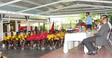 Minister of sport Dr Frank Anthony speaking at the opening ceremony of the 2013 Digicel senior Caribbean Squash Championships at the Georgetown Club Squash Courts. (Orland Charles photo)