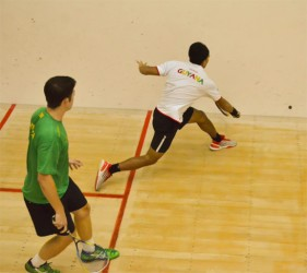 Guyana's Sunil Seth plays a backhand shot during his men's singles final clash against defending champion Chris Binnie. (Photo courtesy of Troy Parboo)