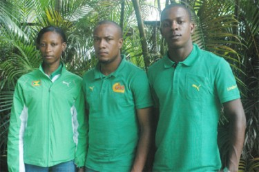 Grenada's Kenisha Pascal (left) and Reon Radix (right) flank national coach, Kwame Hypolite, at a press briefing held at Olympic House shortly after arriving in Guyana for the fourth Boyce & Jefford Classic this weekend.