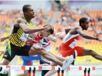 Jehue Gordon (out front in red and white) who looked impressive through the rounds of the men's 400m hurdles