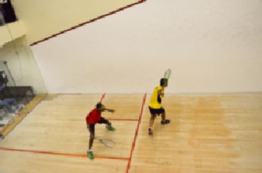 Guyana and Trinidad and Tobago players during their team playoff yesterday afternoon in the Digicel 2013 Senior Caribbean Squash Championship at the Georgetown Club.