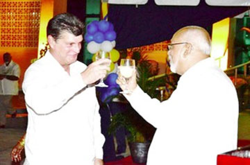 Toasting 40 years: Cuban Ambassador to Guyana Raul Gortázar Marrero toasting the 40 years Cuba-Guyana relations with President Donald Ramotar (at right) during an observances last December to mark the anniversary (GINA photo)