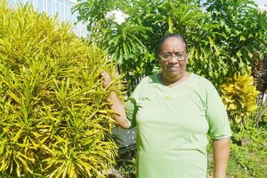 Neisha among her flower plants
