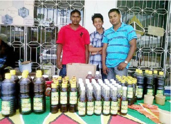 Ravi Rajkumar, his son (centre) and a friend displaying their product