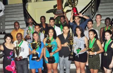 Overall 2013 Senior Caribbean Squash Championships Team Champions Guyana with the spoils. (Orlando Charles photo)