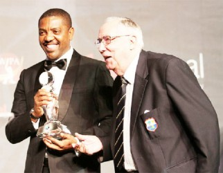I wasn't expecting anything like that! Jackie Hendriks seen here receiving the award from WICB President Dave Cameron.