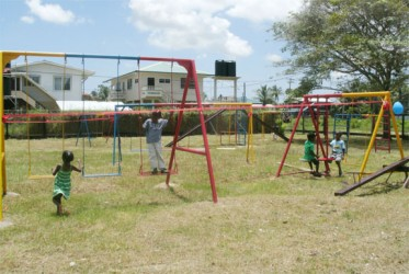 Children making full use of the playground equipment donated by the GAIL Foundation to the New Amsterdam Special Needs School in Berbice