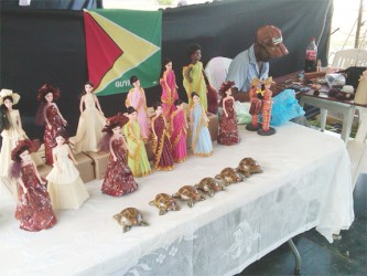 Elaborately clothed dolls and turtles