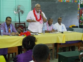 President Donald Ramotar speaking to the gathering. At left is Minister of Natural Resources, Robert Persaud and to the president's immediate right is Chairman of Region Five, Bindrabhan Bisnauth